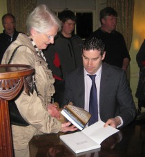 Author Ciarán Reilly signing a copy at the book launch