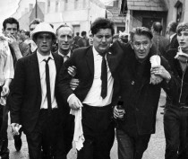 John Hume assisted from civil rights demonstration