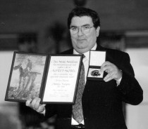 John Hume displays Nobel Peace Prize medal and certificate